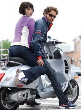 Models wearing Fila on a small motorcycle